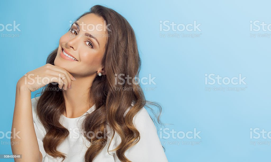 Smiling Woman Over Blue Background stock photo