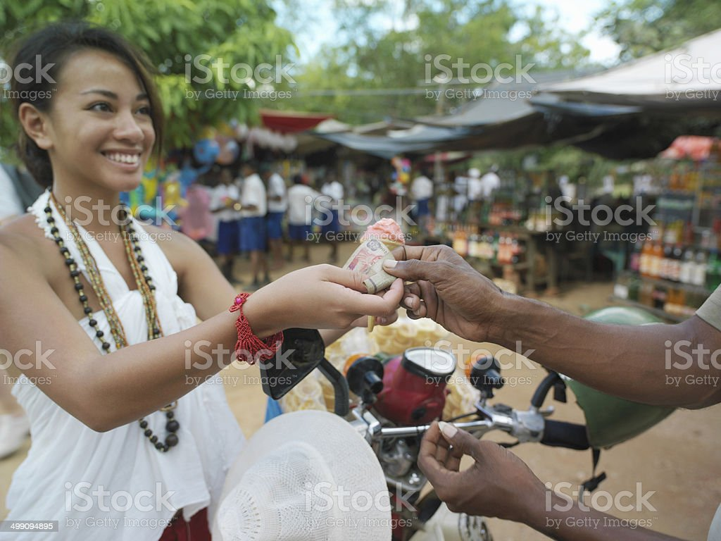 Smiling Woman Paying At Street Market stock photo