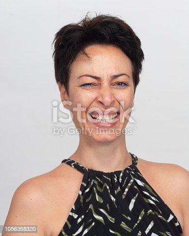 882495390 istock photo Smiling woman 1056358320