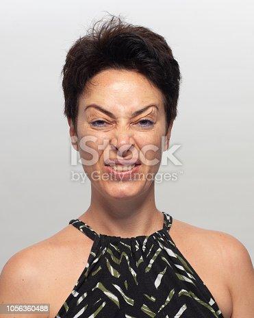 882495390 istock photo Smiling woman 1056360488