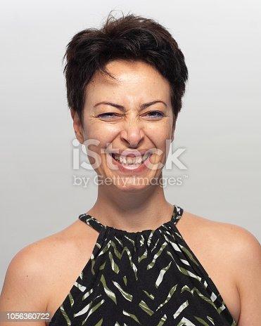 882495390 istock photo Smiling woman 1056360722