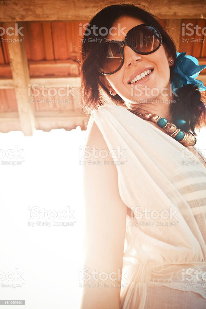 Smiling woman Portrait of beautiful woman on tropical vacation, smiling at camera. 30-34 Years Stock Photo
