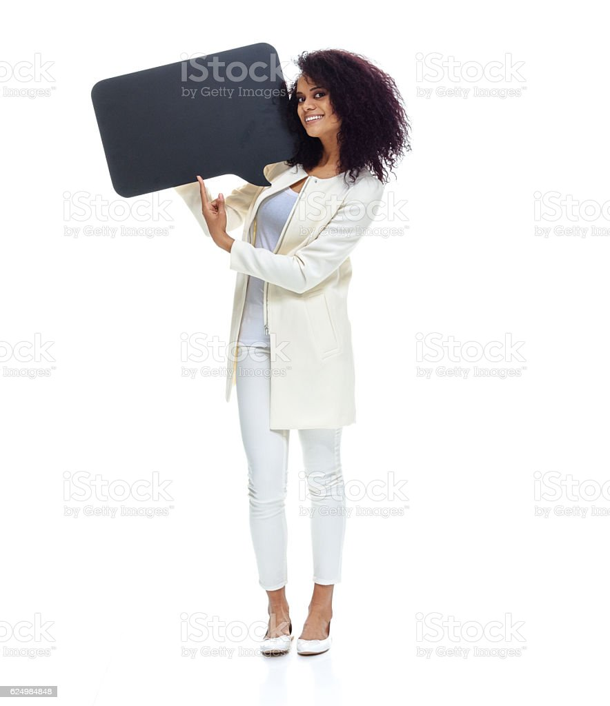Smiling woman pointing at speech bubble stock photo