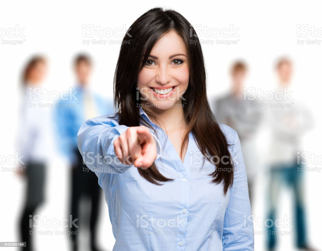 Smiling woman pointing her finger to you stock photo
