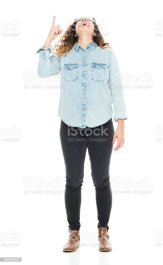 Smiling woman pointing up royalty-free stock photo