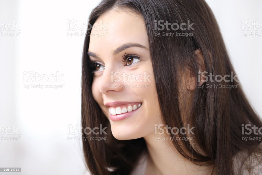 smiling woman portrait in profile looking, isolated on white stock photo