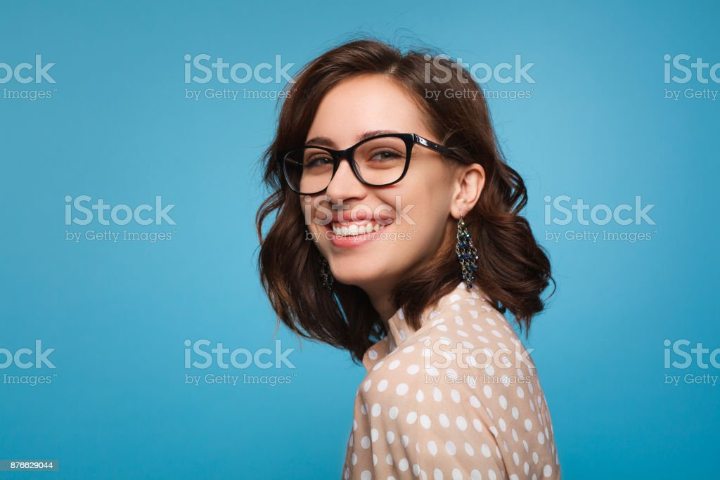 Smiling woman posing in glasses stock photo