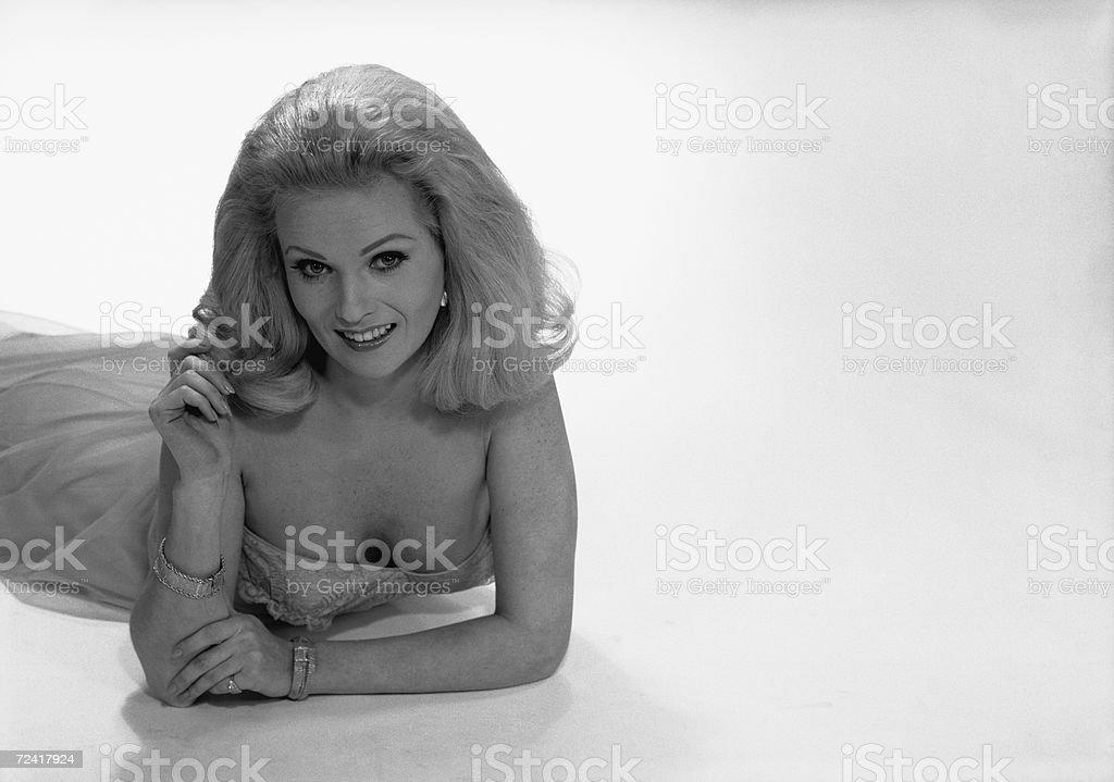 Smiling woman posing in studio, (B&W), portrait royalty-free stock photo