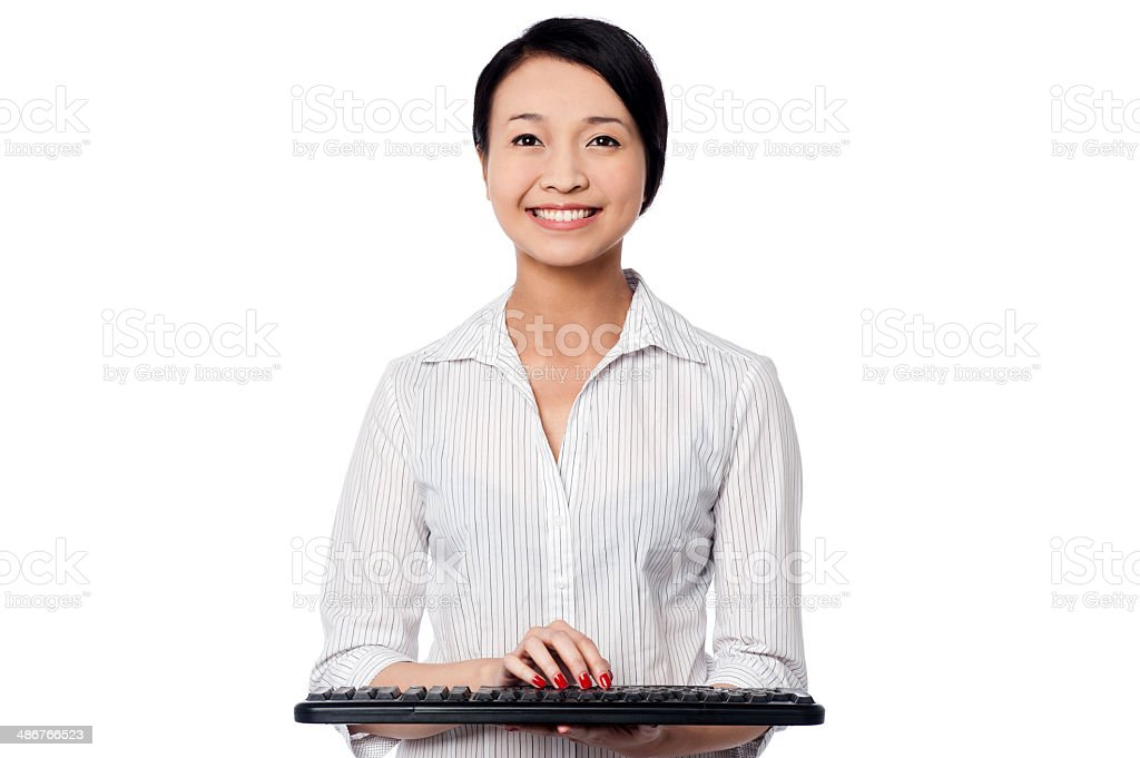 Smiling woman posing with keyboard royalty-free stock photo