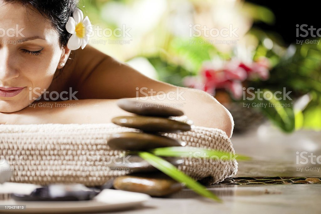 Smiling woman receiving massage at the spa resort. stock photo