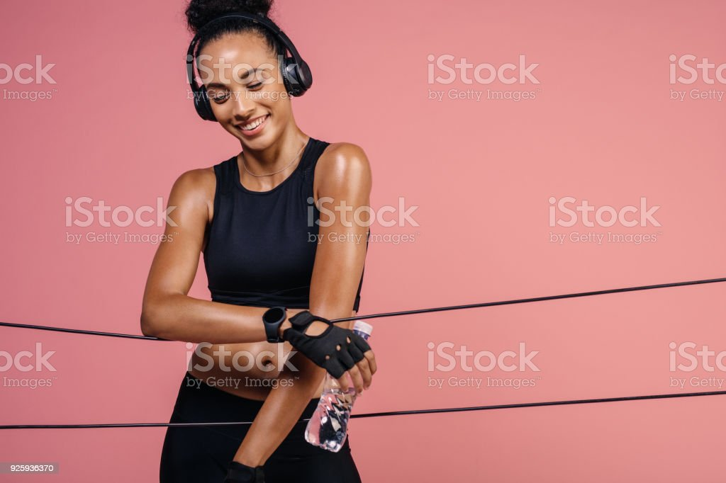 Smiling woman resting after workout stock photo