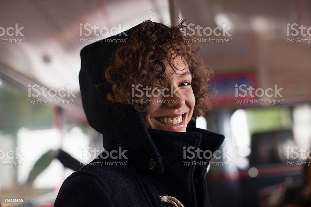 Smiling woman riding bus royalty-free stock photo