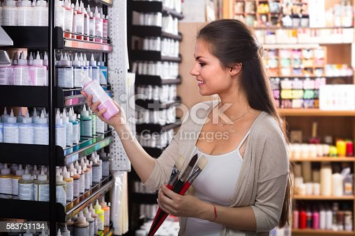 594918592 istock photo Smiling woman shopping various color in tube 583731134