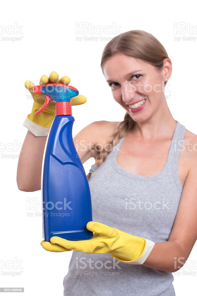 Smiling woman showing bottle of chemistry for cleaning house stock photo