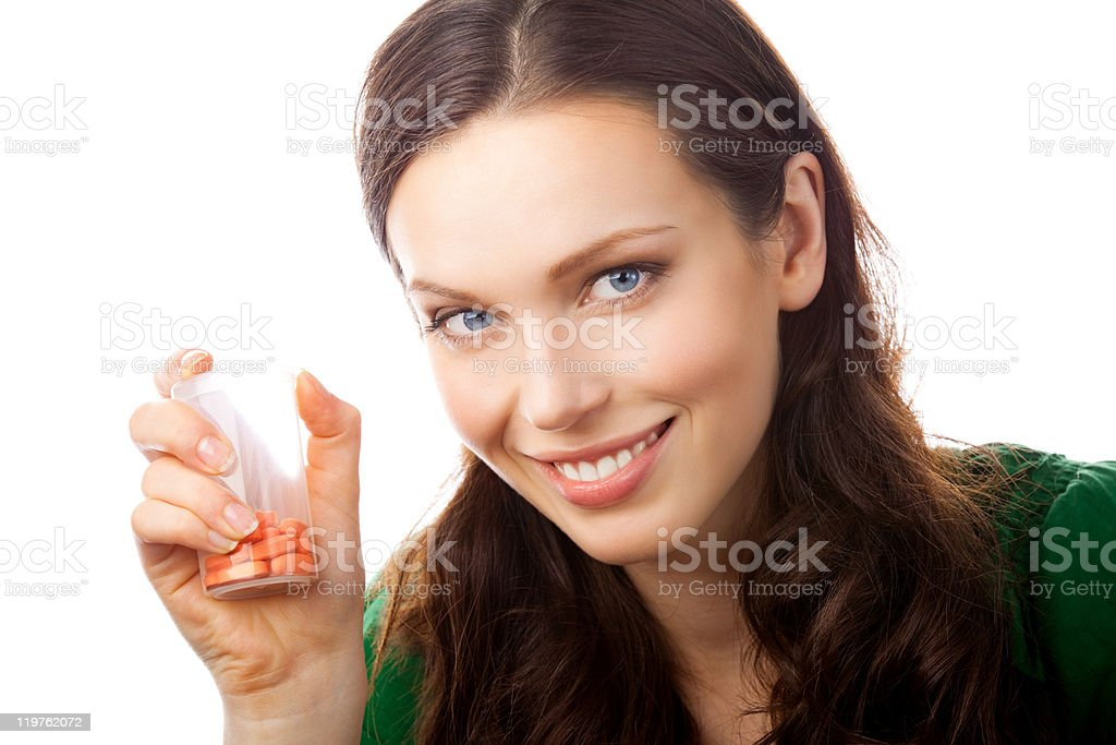Smiling woman showing bottle with pills, isolated royalty-free stock photo