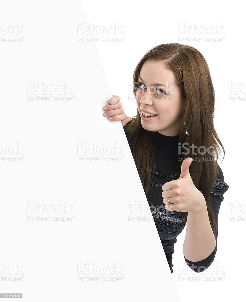 smiling woman showing thumbs-up sign royalty-free stock photo