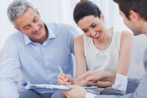 Smiling Woman Sign On A Contrat With Her Partnership Stock Photo - Download Image Now