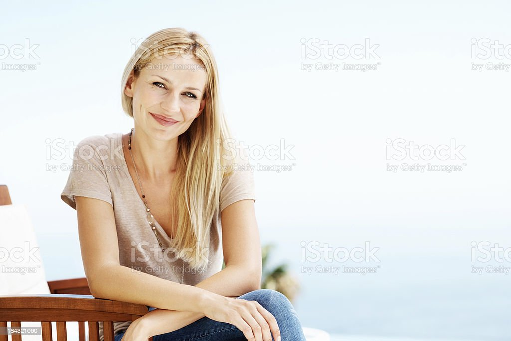 Smiling woman sitting in chair royalty-free stock photo