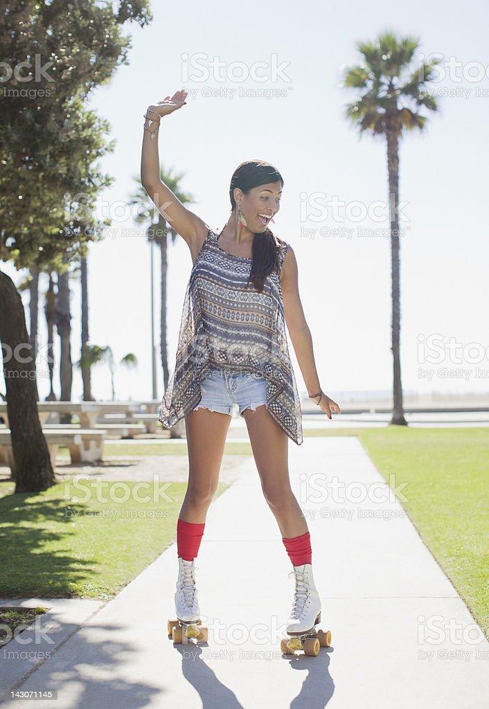 Smiling woman skating in park royalty-free stock photo