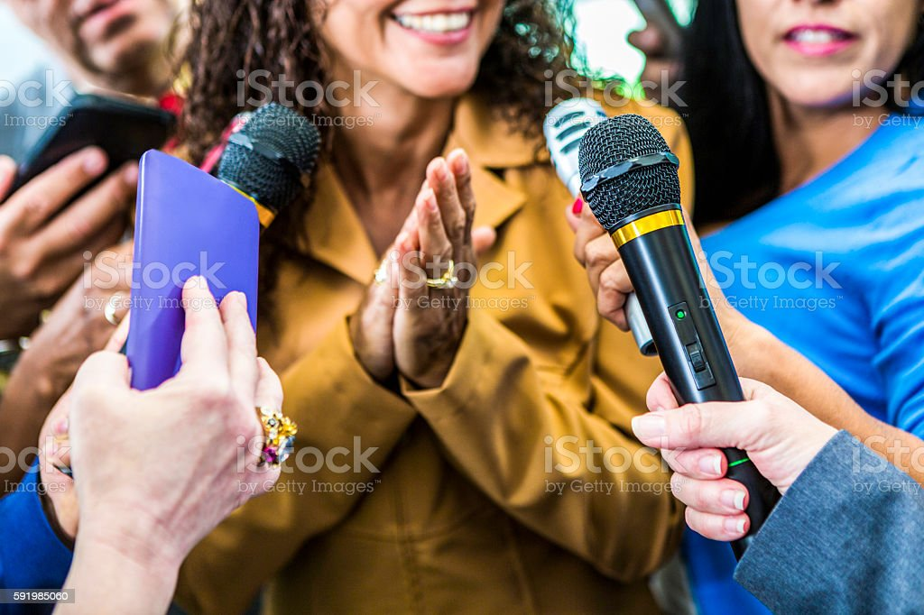 Smiling woman speaks to media stock photo