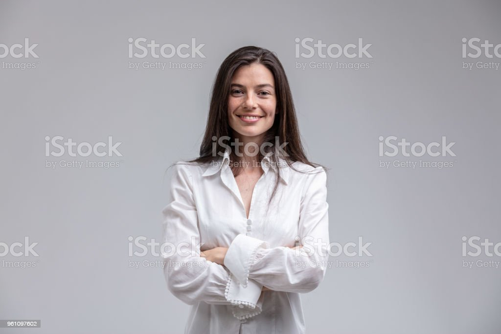 Smiling woman standing with arms crossed royalty-free stock photo