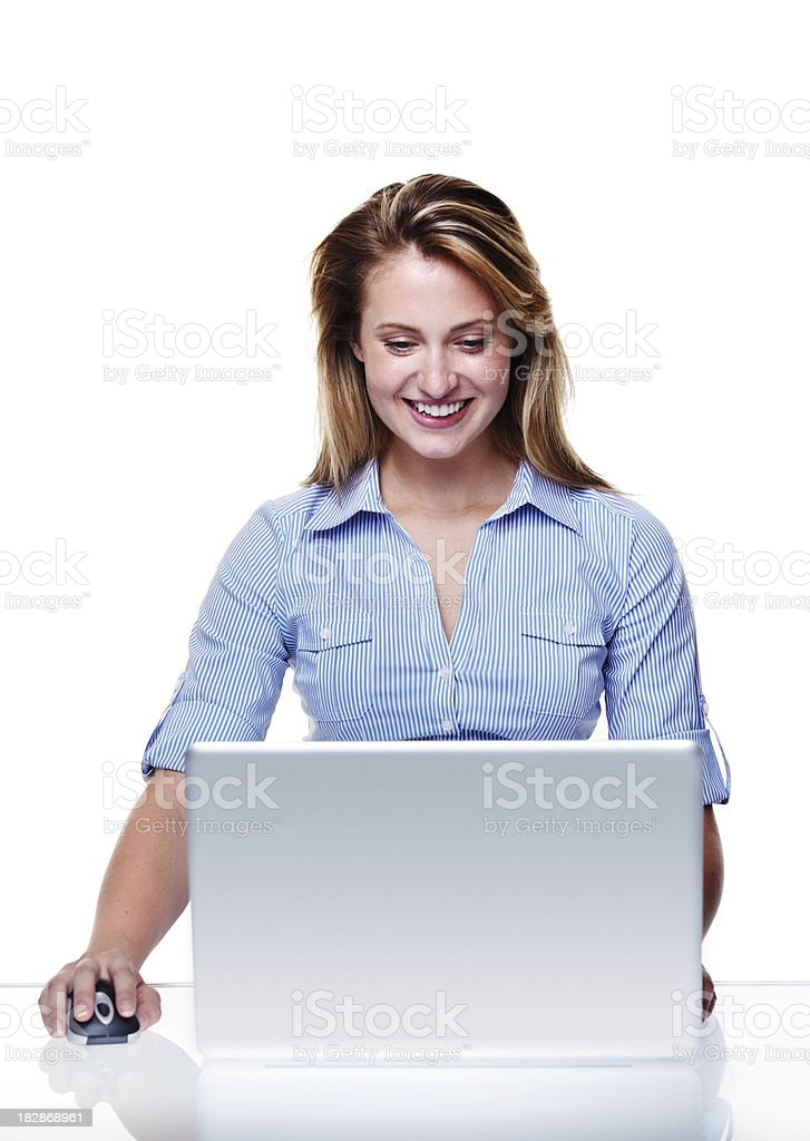 Smiling woman surfing the internet on laptop royalty-free stock photo