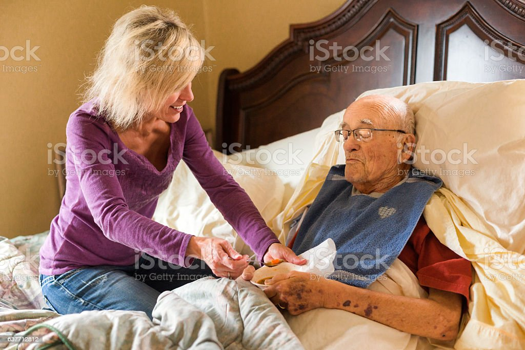 Smiling woman takes care of her Dad stock photo