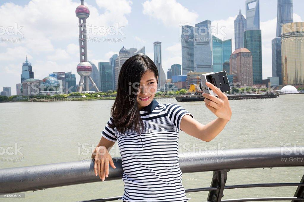 Smiling woman taking selfie stock photo