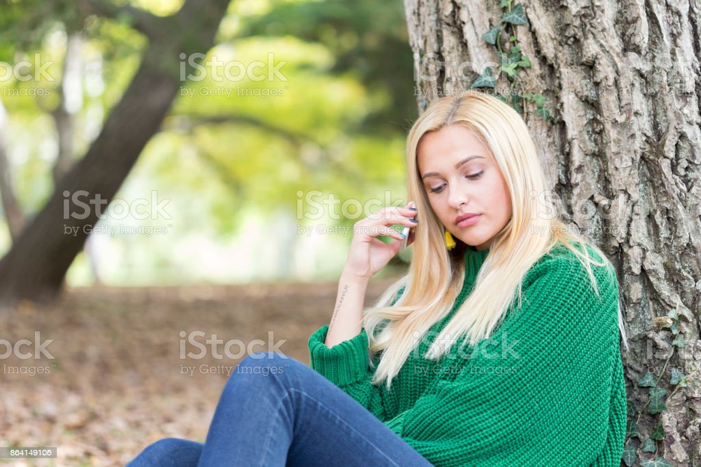 Smiling woman talking on her phone royalty-free stock photo