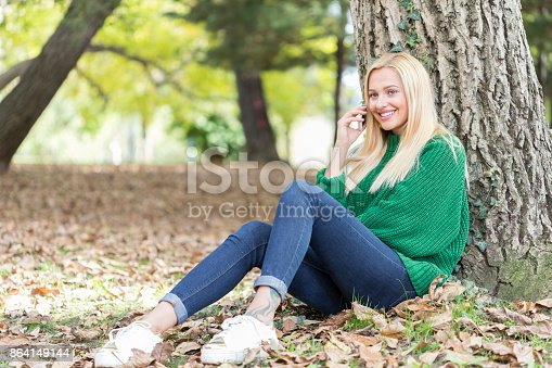 Smiling Woman Talking On Her Phone Stock Photo & More Pictures of Adult
