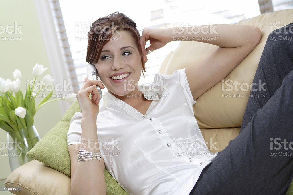 Smiling woman talking on phone royalty-free stock photo