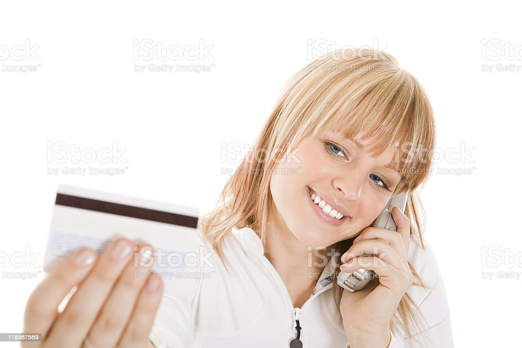 Smiling  woman talking on the phone with her credit card royalty-free stock photo