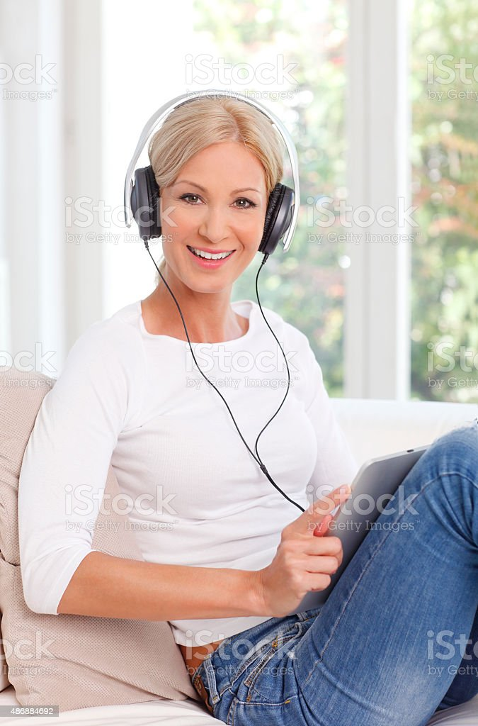 Smiling woman using digital tablet stock photo