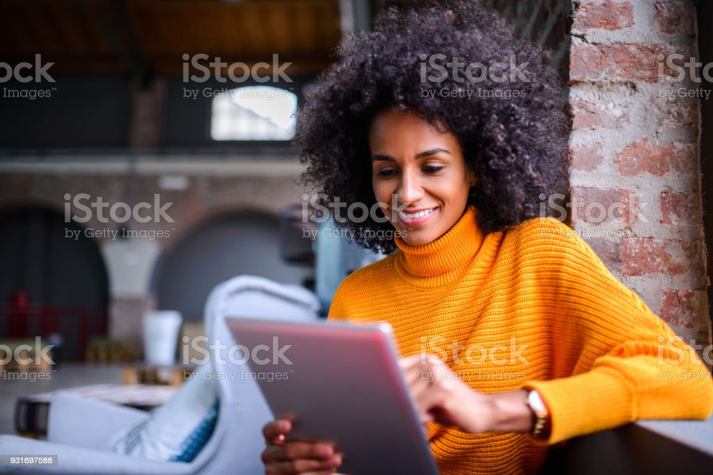 Smiling woman using digital tablet. stock photo