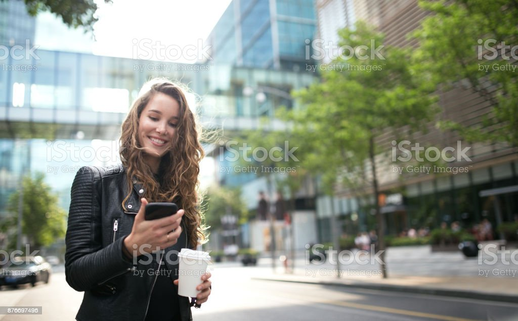Smiling woman using mobile phone. stock photo