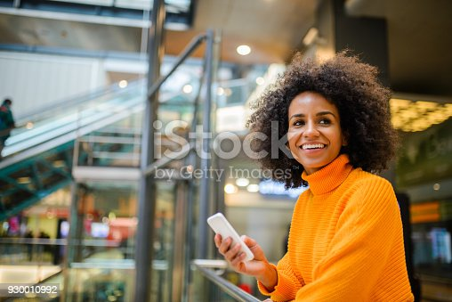 istock Smiling woman using mobile phone. 930010992