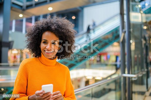 istock Smiling woman using mobile phone. 930011320