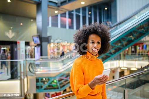 istock Smiling woman using mobile phone. 931697798