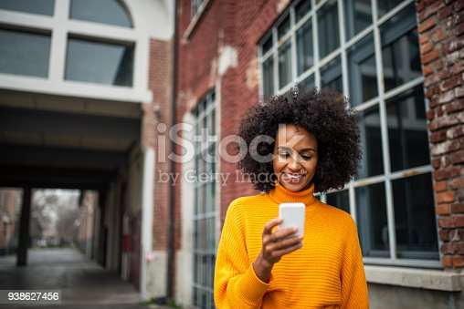 istock Smiling woman using mobile phone. 938627456