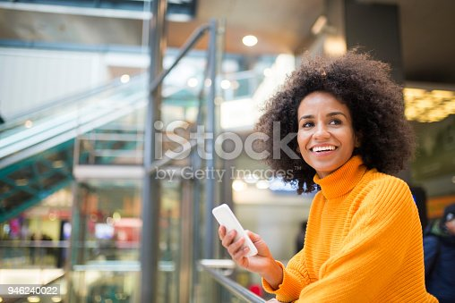 istock Smiling woman using mobile phone. 946240022