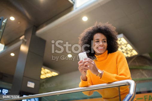 istock Smiling woman using mobile phone. 948675328