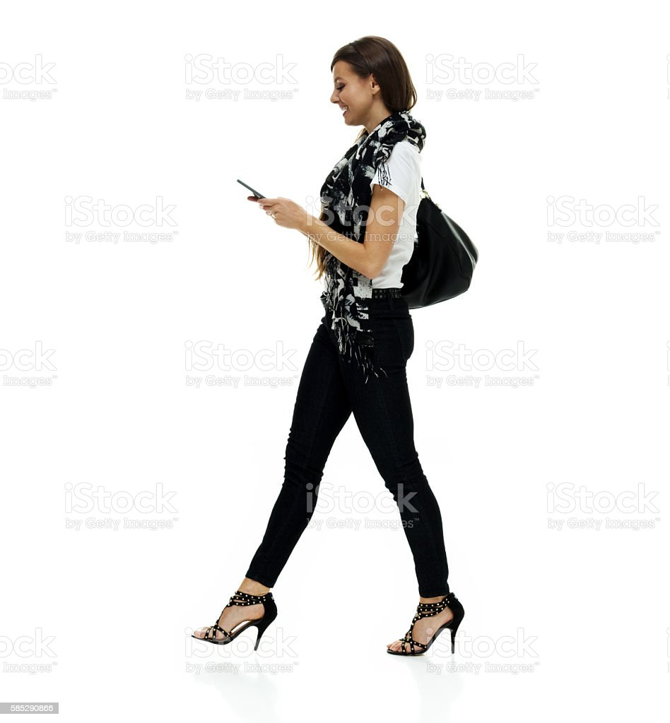 Smiling woman using phone stock photo