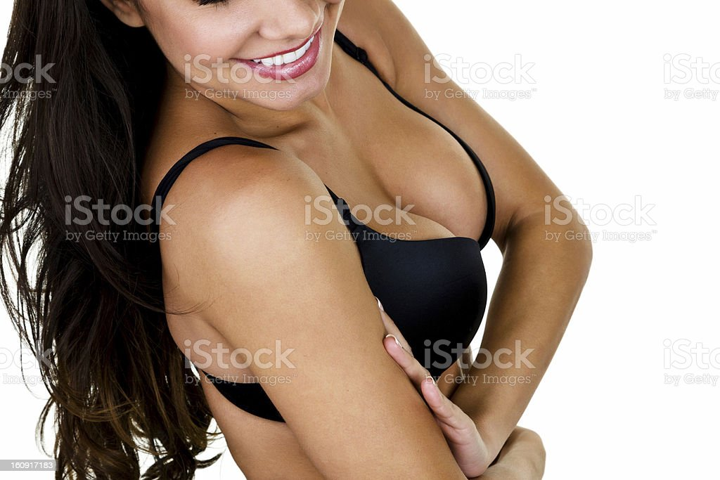 Smiling woman wearing a black bra stock photo