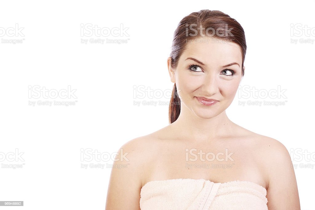 Smiling woman wearing bath towel royalty-free stock photo