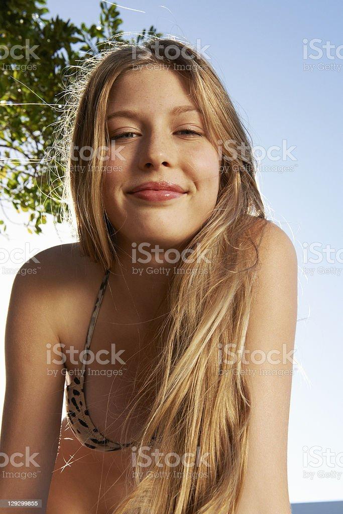 Smiling woman wearing bikini outdoors stock photo