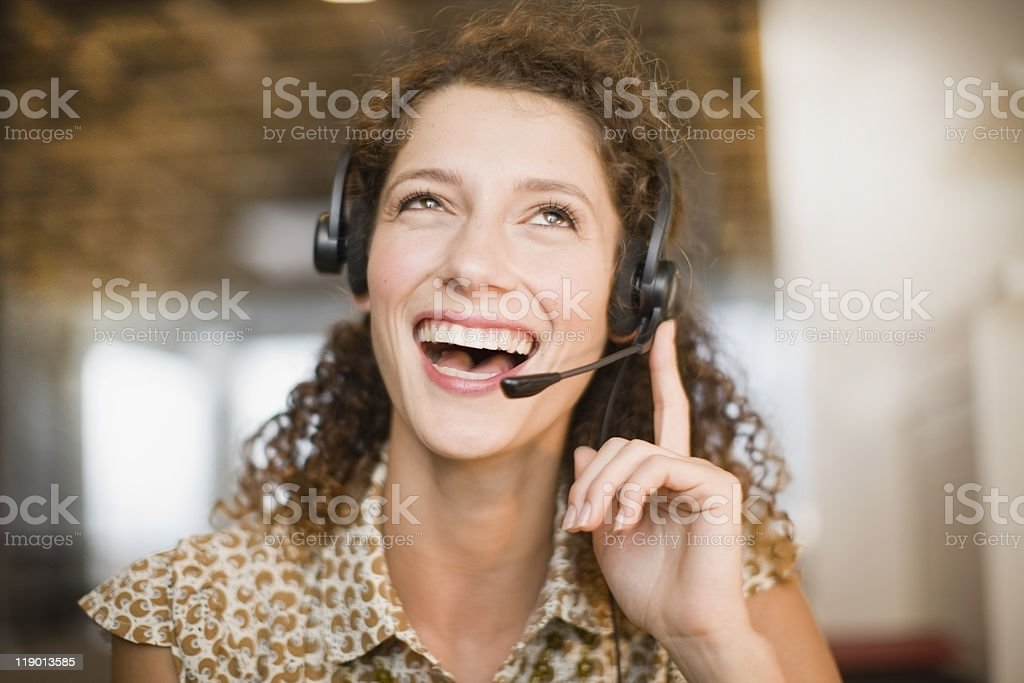 Smiling woman wearing headset  20-24 Years Stock Photo