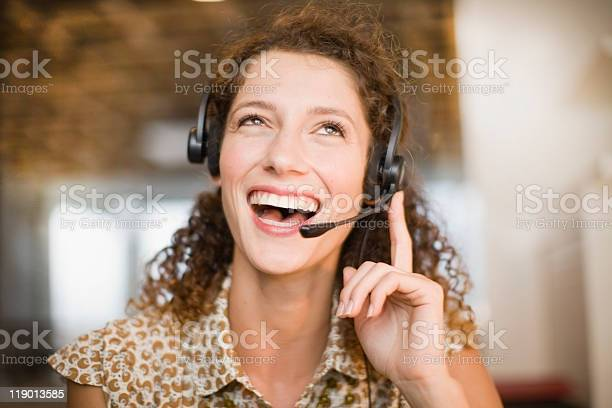 Smiling Woman Wearing Headset Stock Photo - Download Image Now