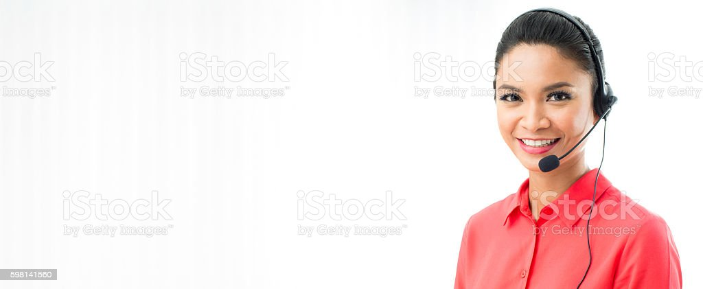 Smiling woman wearing microphone headset, call center banner background stock photo