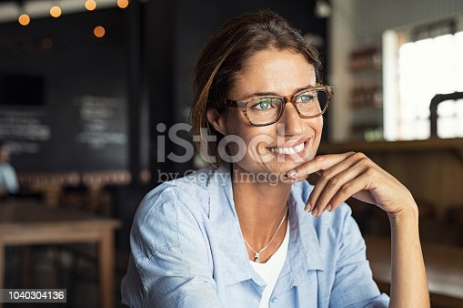 istock Smiling woman wearing spectacles 1040304136