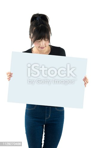 157609352 istock photo Smiling woman with a blank board 1129270456